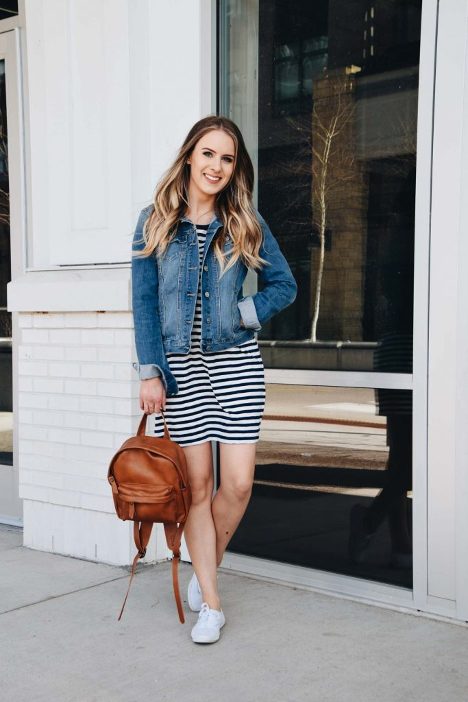 Lauren Meyer wearing a striped t-shirt dress with jean jacket